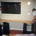 David Hutchins and Mark install top to 1st console desk