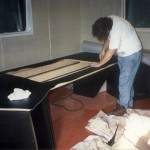 Putting the groovy black linoleum on the Top