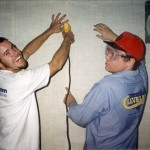 Curtis Green and Mark install wall covering
